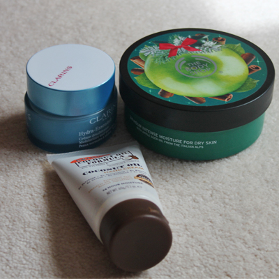 Palmers hand cream, clarins moisturiser and body shop body butter